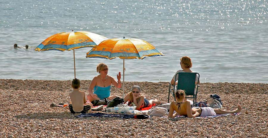 People enjoying Bexhill beach
